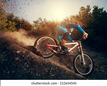 Downhill mountain bike. Man cyclist to riding a bicycle.
