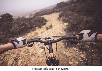 Downhill pov view with mountain bike