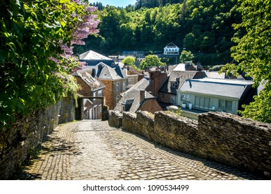 Downhill road to an ancient village in the Belgian Ardennes