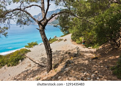 Downhill to sand dunes of Agios Pavlos beach from e4 trail between Loutro and Agia Roumeli at south-west of Crete island, Greece