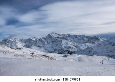 Downhill slope and apres ski mountain hut with restaurant terrace in the Italian Alps, Europe, Italy. Ski area Santa Caterina Valfurva