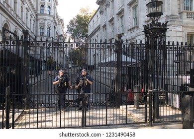 Downing street 10, London/England - October 11 2018: Armed guards guarding downing street 10 the residence of the prime minister of the United Kingdom