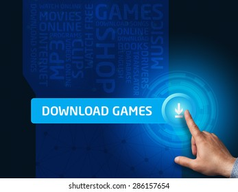 Download games.Businessman presses a button on the virtual screen. Business, technology, internet and networking concept.