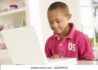 Downs Syndrome boy with laptop