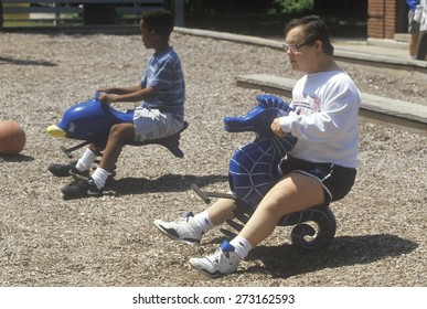 Downs Syndrome child playing in Chicago, Illinois playground