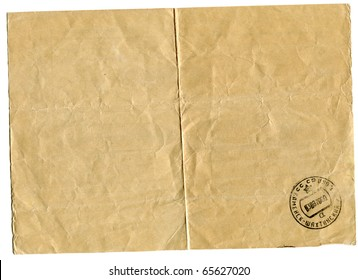 downside of an old weathering  telegram bearing the stamp of post office isolated on white background
