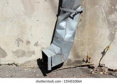 Downspout waterspout smashed rainwater drainage pipe building