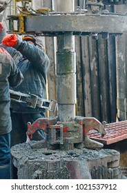 downstream of a pipe for oil production. Drilling an oil well inside a drilling rig. The process of drilling a well.