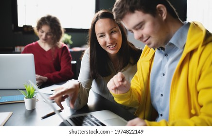 Down-syndrome man attending education class in community center, inclusivity of disabled person. - Shutterstock ID 1974822149