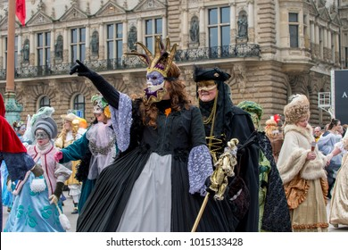 "Downton Hamburg, Germany - January 27, 2018: Celebrating carnival ""Maskenzauber"", a street festival as a tribute to the original in Venice"