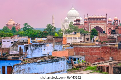 Downtown of Agra with Taj Mahal in background on sunset