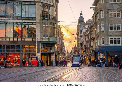 Downtown Amsterdam city skyline. Cityscape  in Netherlands at sunset