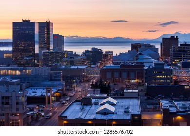 Downtown Anchorage, Alaska city skyline at twilight time during winter.  Looking west towards Cook Inlet.