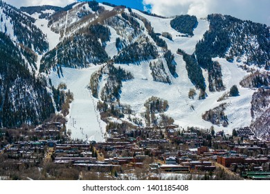 Downtown Aspen, Colorado in the Winter During the Day with the Mountains in the Background