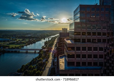 Downtown Austin, Texas during sunset over streets and Lady Bird Lake.