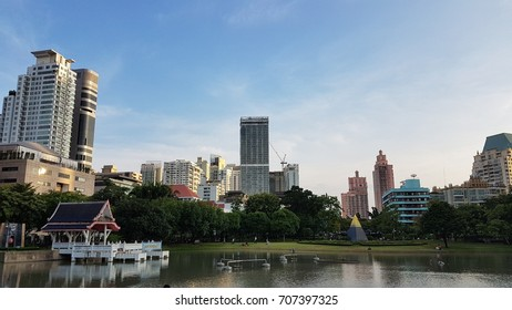 Downtown of Bangkok, Thailand from a pond in Benjasiri Park by wide angle lens using ,city park .