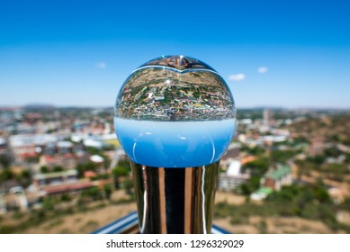 Downtown Bloemfontein, South Africa through a solid glass orb.