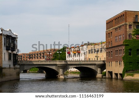 Downtown buildings on the Fox River.  Aurora, Illinois, USA