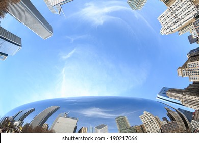 Downtown buildings reflected in the mirror surface of The Bean sculpture in Millennium Park in Chicago, Illinois.