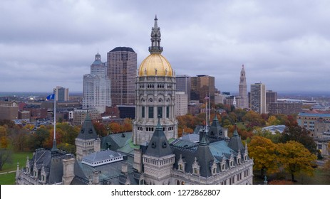 Downtown buildings under a dark sky at the Connecticut state capitol building in Hartford