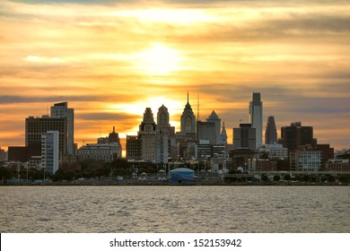 Downtown Center City Philadelphia scenic skyline with skyscraper buildings and Old City historic landmarks on the Delaware River at Sunset