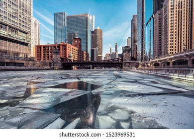 Downtown Chicago in winter, ice on Chicago River during polar vortex