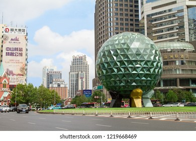Downtown of the Chinese city Dalian. Friendship square. Street of metropolis. Travel in China. Dalian, China - august 12, 2018