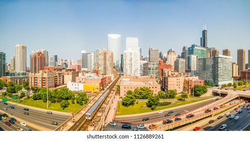 Downtown cityscape with elevated train and traffic. Panorama. West Loop, Chicago, USA. Interstate 90 at Lake Street.