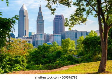 Downtown Cleveland, Ohio, in morning light framed by trees in a small park