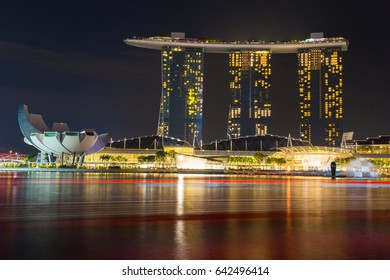 DOWNTOWN CORE, SINGAPORE - MAY 2017 : Singapore modern city night landscape at Downtown Core and Marina Bay near Merlion and beautiful buildings.