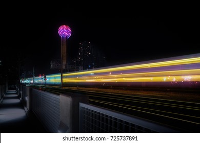 Downtown Dallas with light trails from passing train.