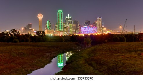Downtown Dallas skyline at night from the Trinity River in Texas, USA.