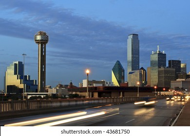 Downtown Dallas Texas at night just after sunset.  Traffic is coming at the camera and creates a nice blur.