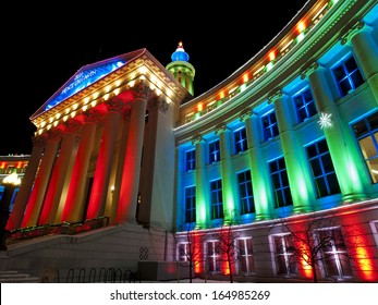 Downtown Denver at Christmas. Denver's City and County building decorated with holiday lights.