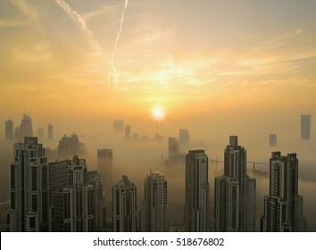 Downtown Dubai is covered by early morning fog