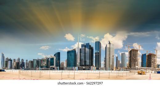 Downtown Dubai panoramic skyline at sunset, UAE.