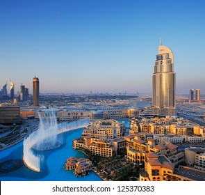 DOWNTOWN DUBAI, UAE - MAY 7 - The Dubai Fountain is set on the 30-acre manmade Burj Khalifa Lake. 63-storey, 302.2 m Address Hotel is visible on the right. Picture taken on May 7, 2010.