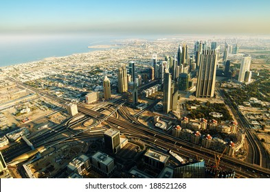 Downtown of Dubai (UAE, United Arab Emirates) in the morning. Aerial view from Burh Khalifa, one of the tallest buildings in the world. Coast of the Persian Gulf in the background.