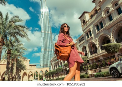Downtown Dubai, United Arab Emirates - 03/05/2015: Luxury lifestyle shot of a casually well dressed woman at the Palace Hotel, Downtown with Burj Khalifa in the background