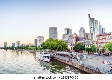Downtown of Frankfurt am Main with skyscrapers and boat on the river, Germany