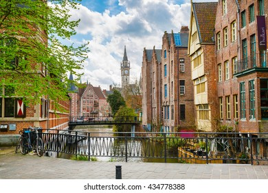 Downtown of Ghent with canal, clock tower, medieval buildings, Belgium