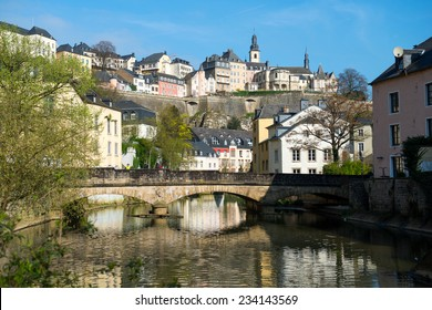 Downtown Grund of Luxembourg City, view with a bridge across the Alzette river