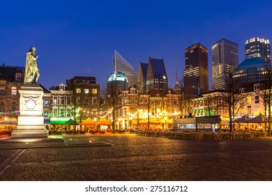 Downtown of The Hague Netherlands, with its monumental old buildings, and modern skyline in the background at dusk