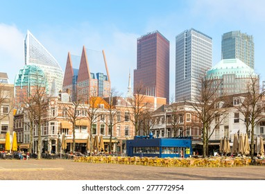 Downtown of The Hague Netherlands, with its monumental old buildings, and modern skyline in the background