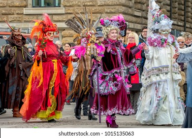 """Downtown Hamburg, Germany - January 27, 2018: Celebrating carnival """"Maskenzauber"""", a street festival as a tribute to the original in Venice"""