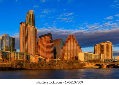 Downtown high-rises reflecting sunset golden hour light viewed across Lady Bird Lake or Town Lake on Colorado River in Austin, Texas, USA