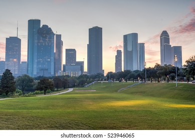 Downtown Houston at epic sunrise dawn twilight with green park lawn and modern skylines. It is the most populous city in Texas and the fourth-most in United States. Architecture and travel background.