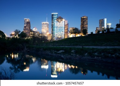 Downtown Houston in the evening. Reflection in the river Buffalo Bayou. Texas, United States