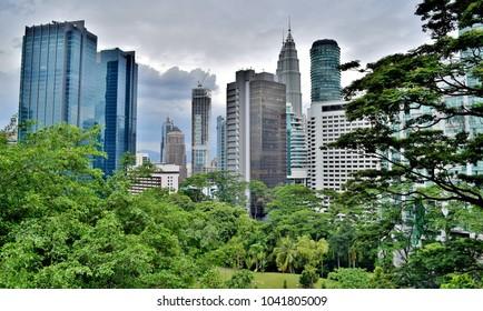 Downtown Kuala Lumpur Skyscrapers (as seen from city park) under Stormy Skies - Kuala Lumpur, Malaysia
