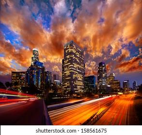 Downtown LA night Los Angeles sunset skyline California from 110 freeway  [ photo-illustration]